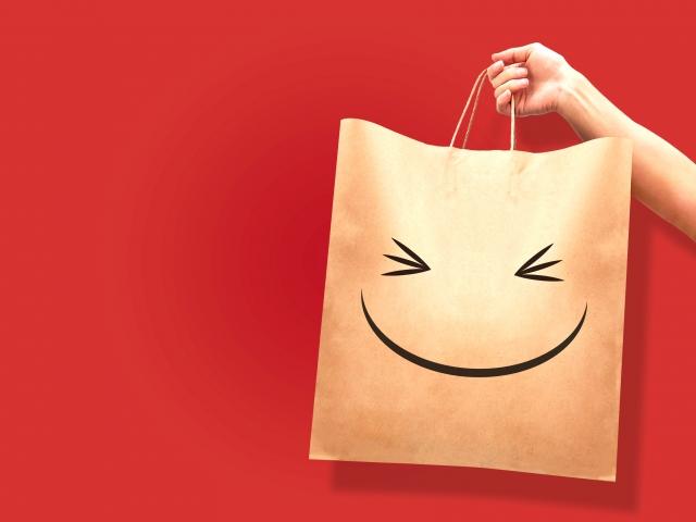 笑顔の書かれた紙袋